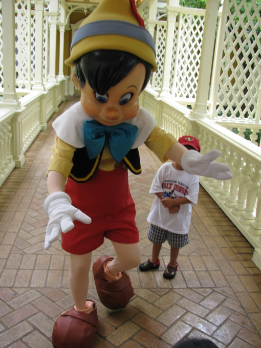 OH NO! The wooden kid trips the real kid with his big-ass shoe!