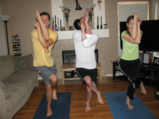 Kenny and Carl have been doing Yoga for about 6 years. I've been doing Yoga for about 6 minutes. That would explain why my arms are pretzeled up in the wrong direction.