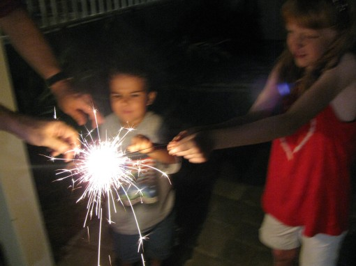 "My brother (Uncle Scott) took over the ""lighting of the sparklers"" duty. I guess he was the most qualified, seeing as how he's a firefighter and all."