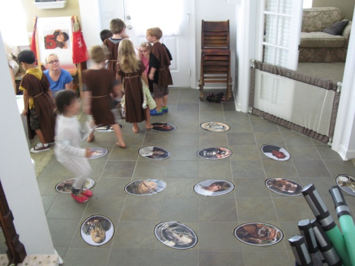 "Mark printed out photos of Star Wars characters and I taped them to the floor. An adult game of ""Name the character"" was also going on. I'm not sure but I think illegal bets were placed."